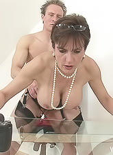 Lady Sonia takes all of her clothes before the camera and strokes off a big hard cock
